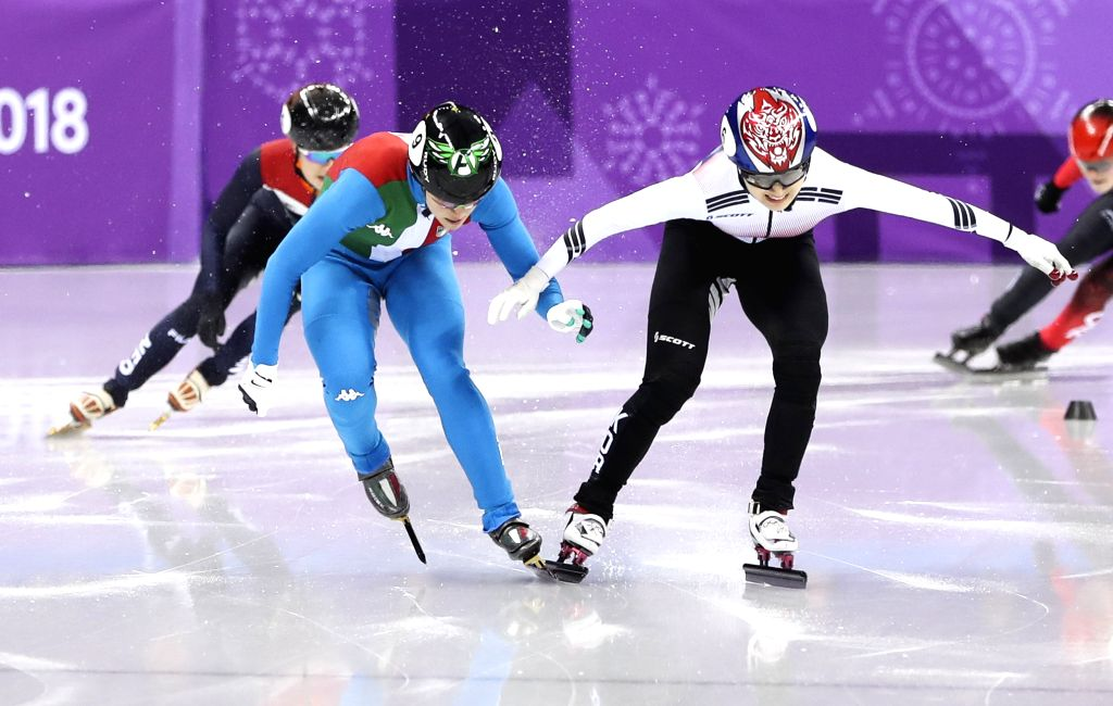 PYEONGCHANG, Feb. 13, 2018 - Italy's Arianna Fontana (front L) collides with South Korea's Choi Minjeong during ladies' 500m final of short track speed skating at the Pyeongchang 2018 Winter Olympic ...