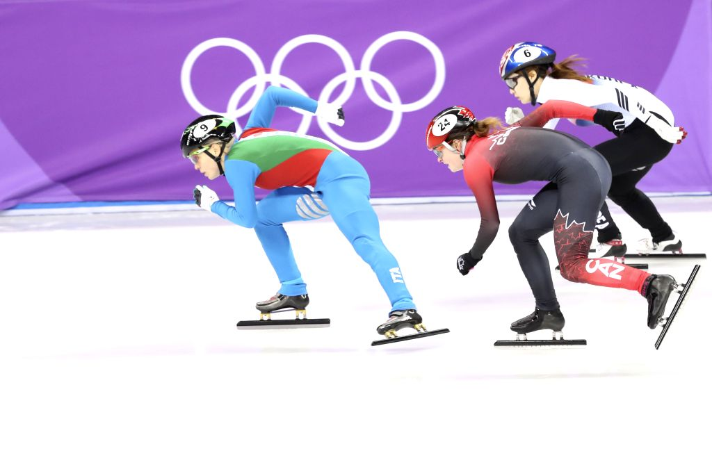 PYEONGCHANG, Feb. 13, 2018 - Italy's Arianna Fontana (L) competes during the ladies' 500m final of short track speed skating at the Pyeongchang 2018 Winter Olympic Games at Gangneung Ice Arena, ...