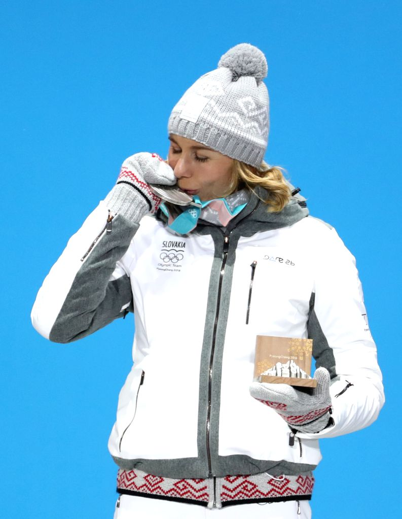 PYEONGCHANG, Feb. 13, 2018 - Second-placed Anastasiya Kuzmina from Slovakia poses for photos during the medal ceremony of women's 10km pursuit event of biathlon at the 2018 PyeongChang Winter Olympic ...