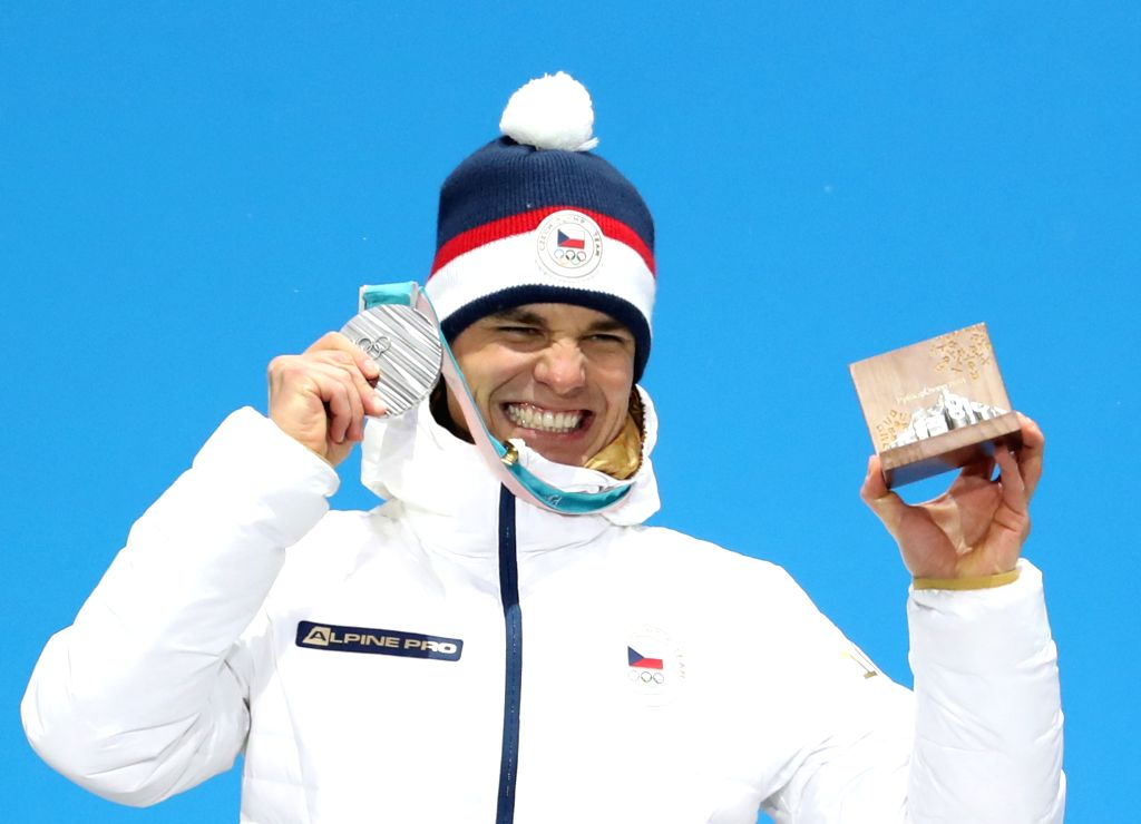 PYEONGCHANG, Feb. 13, 2018 - Second-placed Michal Krcmar from Czech Republic poses for photos during the medal ceremony of men's 10km sprint event of biathlon at 2018 PyeongChang Winter Olympic Games ...