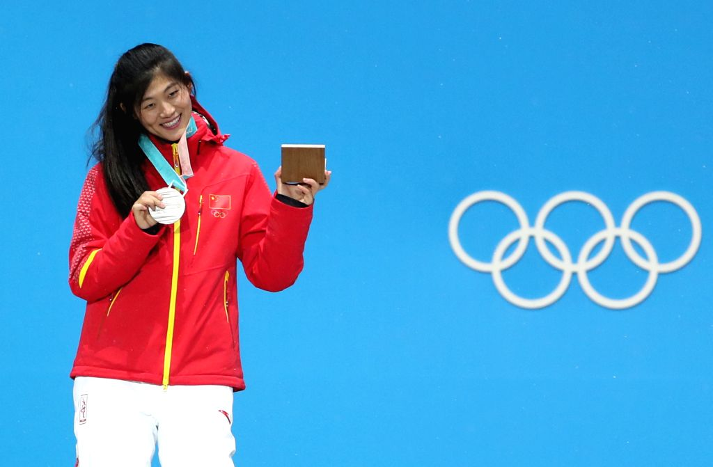 PYEONGCHANG, Feb. 13, 2018 - Silver medalist China's Liu Jiayu poses for photos during the medal ceremony of ladies' halfpipe finals of snowboard at the 2018 PyeongChang Winter Olympic Games at the ...