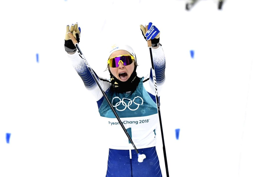 PYEONGCHANG, Feb. 13, 2018 - Stina Nilsson from Sweden crosses finishing line of the ladie's sprint classic final of cross-country skiing at the Pyeongchang 2018 Winter Olympic Games at Alpensia ...