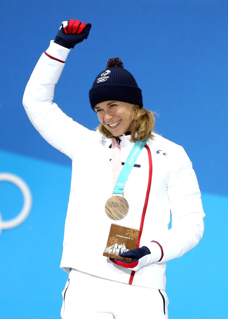 PYEONGCHANG, Feb. 13, 2018 - Third-placed Anais Bescond from France celebrates during the medal ceremony of women's 10km pursuit event of biathlon at the 2018 PyeongChang Winter Olympic Games at the ...