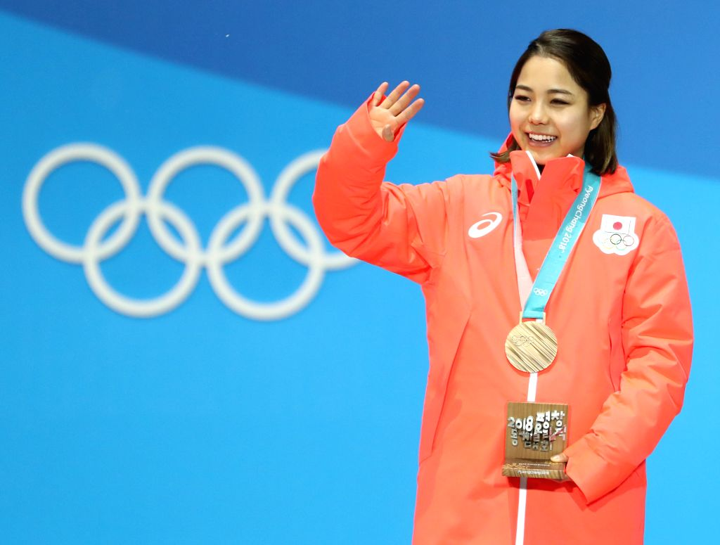 PYEONGCHANG, Feb. 13, 2018 - Third-placed Sara Takanashi from Japan celebrates during the medal ceremony of ladies' normal hill individual event of ski jumping at 2018 PyeongChang Winter Olympic ...
