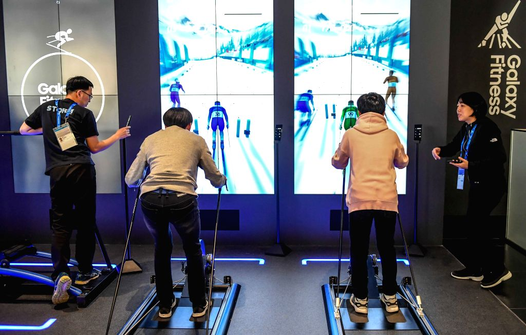 PYEONGCHANG, Feb. 13, 2018 - Visitors try a simulated skiing game at the Gangneung Olymic Park, South Korea, on Feb. 13, 2018. As the 2018 PyeongChang Winter Olympic Games is being held from Feb. 9 ...