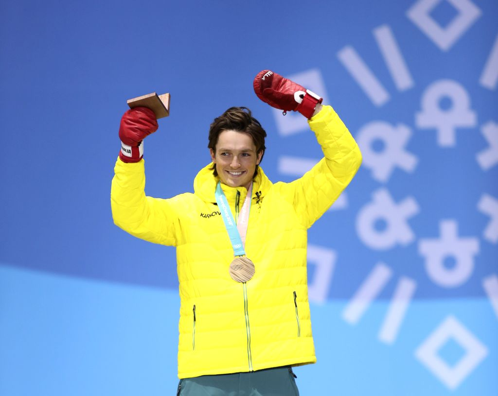 PYEONGCHANG, Feb. 14, 2018 - Bronze medalist Scotty James of Australia celebrates during medal ceremony of men's halfpipe event of snowboard at 2018 PyeongChang Winter Olympic Games at the Medal ...