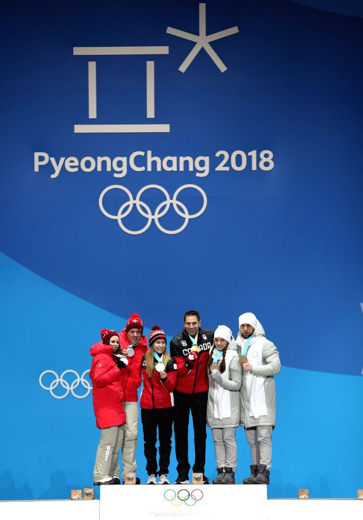 PYEONGCHANG, Feb. 14, 2018 - Champion Kaitlyn Lawes (3rd L) and John Morris (3rd R) of Canada, silver medalists Jenny Perret (1st L) and Martin Rios (2nd L) of Switzerland and Bronze medalists ...