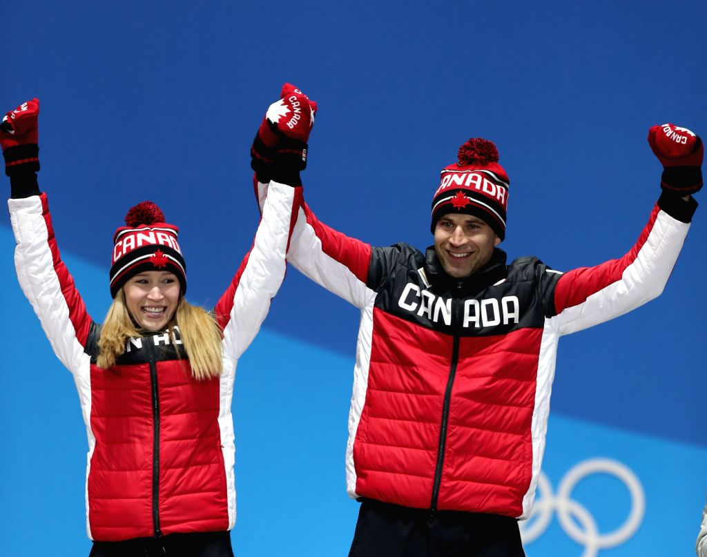 PYEONGCHANG, Feb. 14, 2018 - Champion Kaitlyn Lawes (L) and John Morris of Canada celebrate during medal ceremony of the mixed doubles event of curling at 2018 PyeongChang Winter Olympic Games at the ...