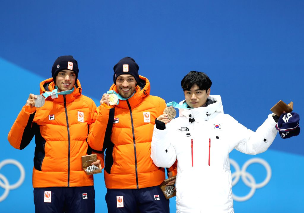 PYEONGCHANG, Feb. 14, 2018 - Champion Kjeld Nuis (C) from the Netherlands, second-placed Patrick Roest (L) from the Netherlands and third-placed Kim Min Seok from South Korea pose for photos during ...