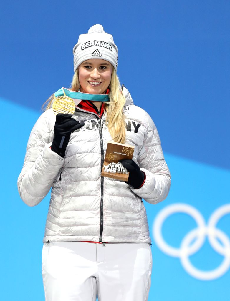 PYEONGCHANG, Feb. 14, 2018 - Champion Natalie Geisenberger from Germany poses for photos during medal ceremony of women's singles event of luge at 2018 PyeongChang Winter Olympic Games at the Medal ...