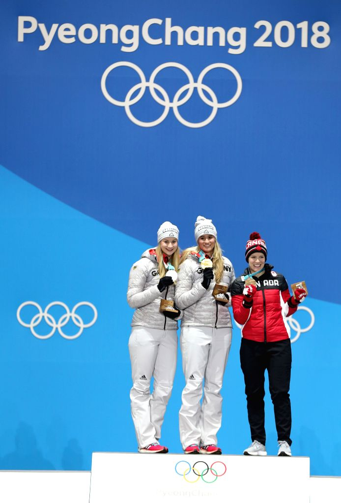 PYEONGCHANG, Feb. 14, 2018 - Champion Natalie Geisenberger (C) from Germany, second-placed Dajana Eitberger from Germany (L) and third-placed Alex Gough from Canada pose for photos during medal ...