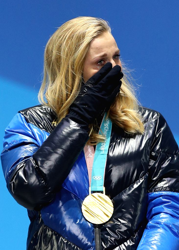 PYEONGCHANG, Feb. 14, 2018 - Champion Stina Nilsson from Sweden reacts during medal ceremony of ladie's sprint classic event of cross-country skiing at 2018 PyeongChang Winter Olympic Games at the ...
