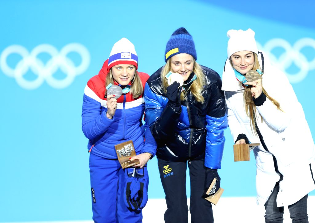 PYEONGCHANG, Feb. 14, 2018 - Champion Stina Nilsson (C) from Sweden, second-placed Maiken Caspersen Falla (L) from Norway and third-placed Olympic athlete from Russia Yulia Belorukova pose for photos ...