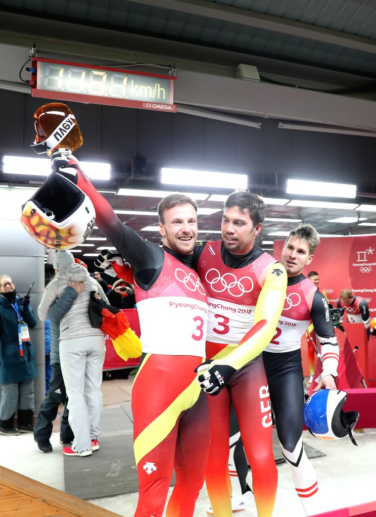 PYEONGCHANG, Feb. 14, 2018 - Champion Tobias Wendl (C) and Tobias Arlt (L) from Germany celebrate after finishing men's doubles event of luge at 2018 PyeongChang Winter Olympic Games at Olympic ...
