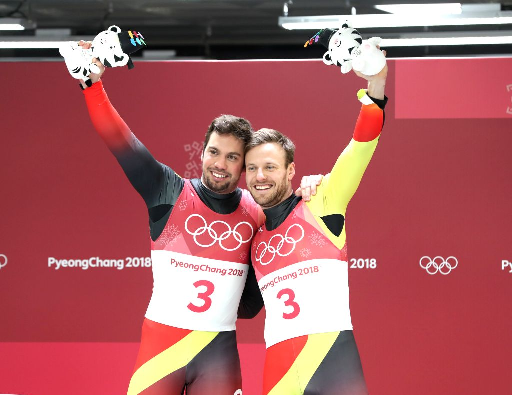 PYEONGCHANG, Feb. 14, 2018 - Champion Tobias Wendl (L) and Tobias Arlt from Germany pose for pictures during venue ceremony of men's doubles event of luge at 2018 PyeongChang Winter Olympic Games at ...