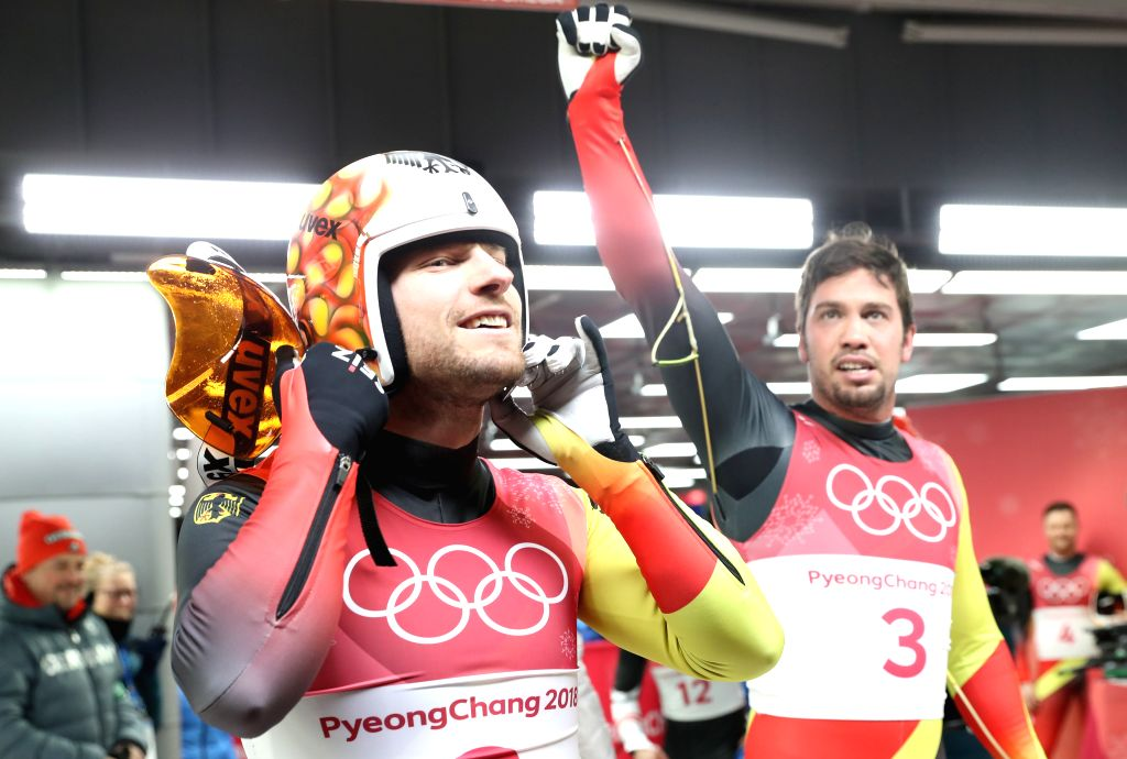 PYEONGCHANG, Feb. 14, 2018 - Champion Tobias Wendl (R) and Tobias Arlt from Germany celebrate after finishing men's doubles event of luge at 2018 PyeongChang Winter Olympic Games at Olympic Sliding ...