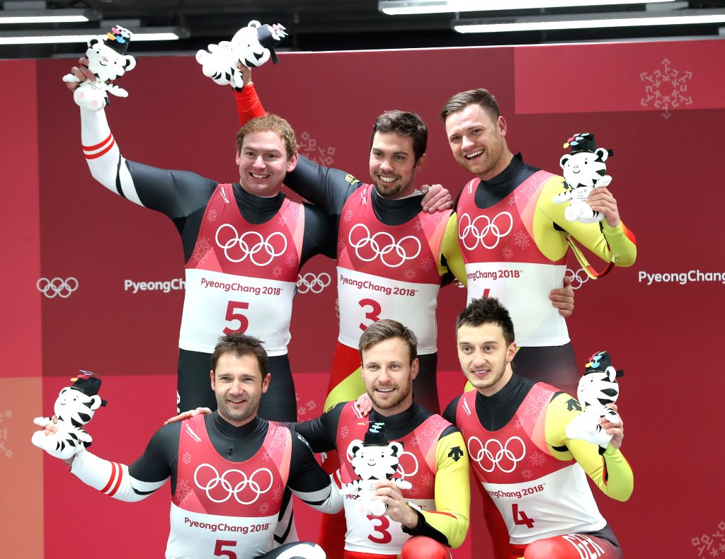PYEONGCHANG, Feb. 14, 2018 - Champion Tobias Wendl (top C) and Tobias Arlt (bottom C) from Germany, second-placed Peter Penz (top L) and Georg Fischler (bottom L) from Austria and third-Placed Toni ...