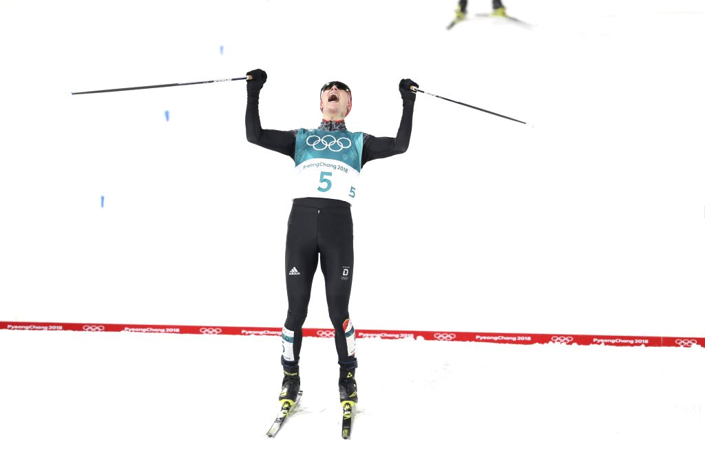 PYEONGCHANG, Feb. 14, 2018 - Eric Frenzel from Germany celebrates after crossing finishing line of individual gundersen NH/10KM event of Nordic Combined at 2018 PyeongChang Winter Olympic Games at ...