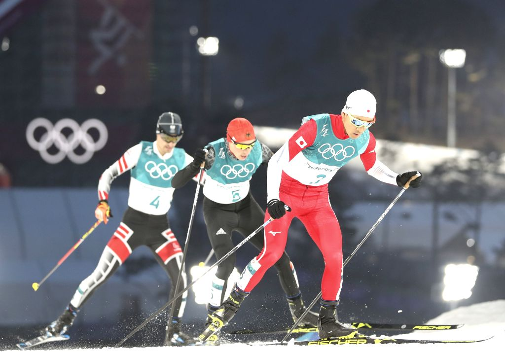 PYEONGCHANG, Feb. 14, 2018 - Gold medalist Eric Frenzel (C)from Germany, silver medalist Akito Watabe (R) from Japan and Lukas Klapfer from Austria compete during individual gundersen NH/10KM event ...
