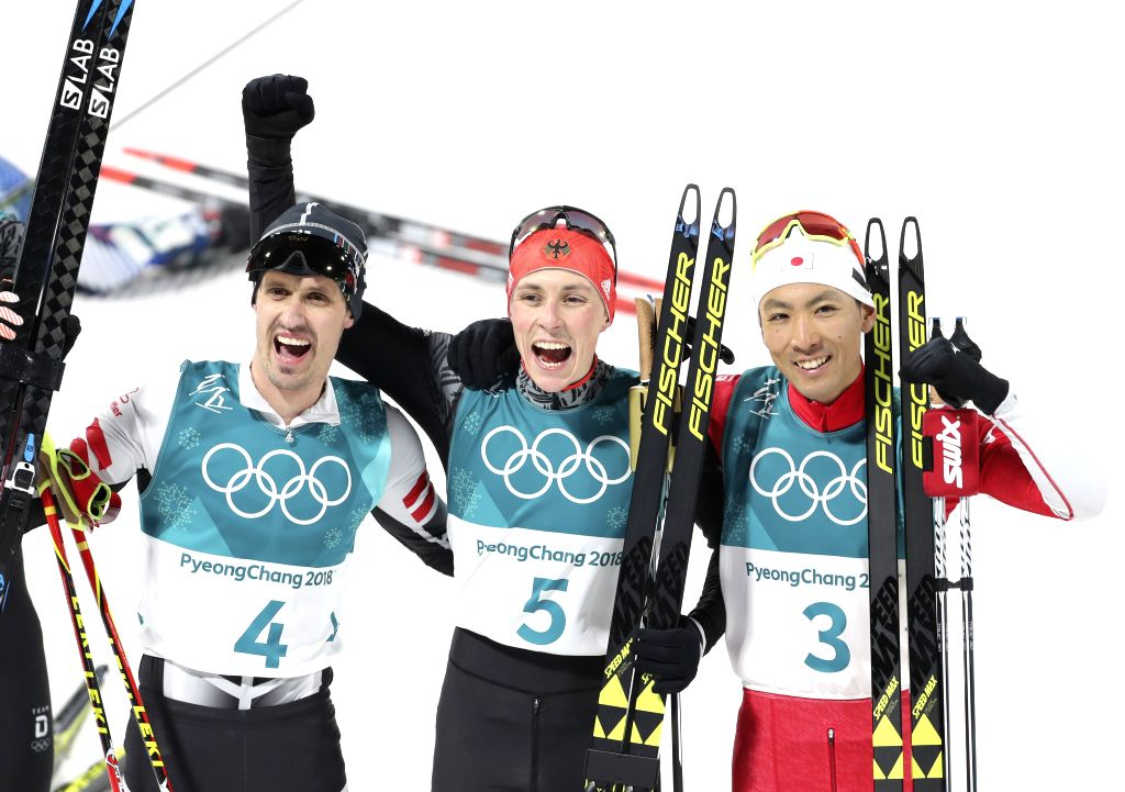 PYEONGCHANG, Feb. 14, 2018 - Gold medalist Eric Frenzel (C) from Germany, silver medalist Akito Watabe (R) from Japan and Lukas Klapfer from Austria pose for photos after finishing individual ...