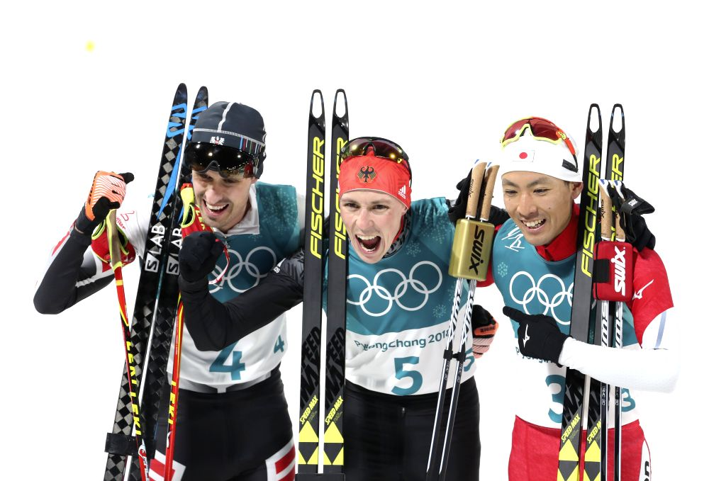 PYEONGCHANG, Feb. 14, 2018 - Gold medalist Eric Frenzel (C)from Germany, silver medalist Akito Watabe (R) from Japan and Lukas Klapfer from Austria pose for photos after finishing individual ...