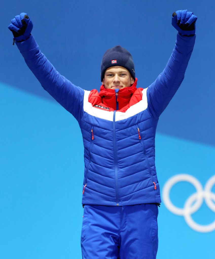 PYEONGCHANG, Feb. 14, 2018 - Gold medalist Johannes Hoesflot Klaebo from Norway celebrates during medal ceremony of cross-country skiing at the Pyeongchang 2018 Winter Olympic Games at the Medal ...