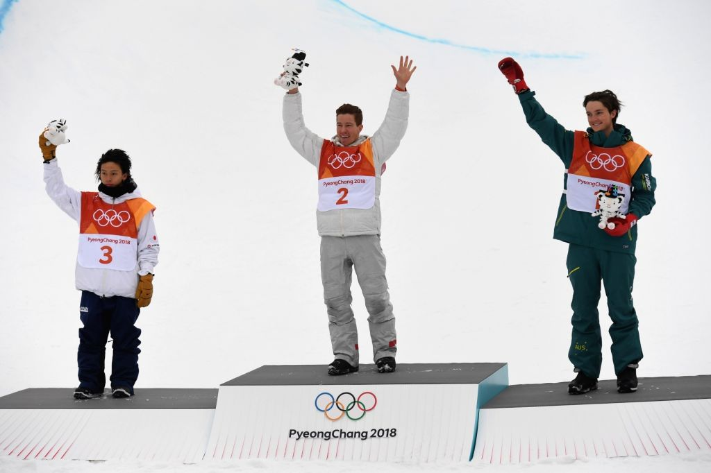 PYEONGCHANG, Feb. 14, 2018 - Gold medalist Shaun White of the U.S. (C), silver medalist Ayumu Hirano of Japan (L) and bronze medalist Scotty James of Australia pose for photos after winning the men's ...