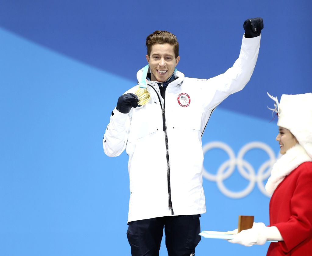 PYEONGCHANG, Feb. 14, 2018 - Gold medalist Shaun White of the United States celebrates during medal ceremony of men's halfpipe event of snowboard at 2018 PyeongChang Winter Olympic Games at the Medal ...