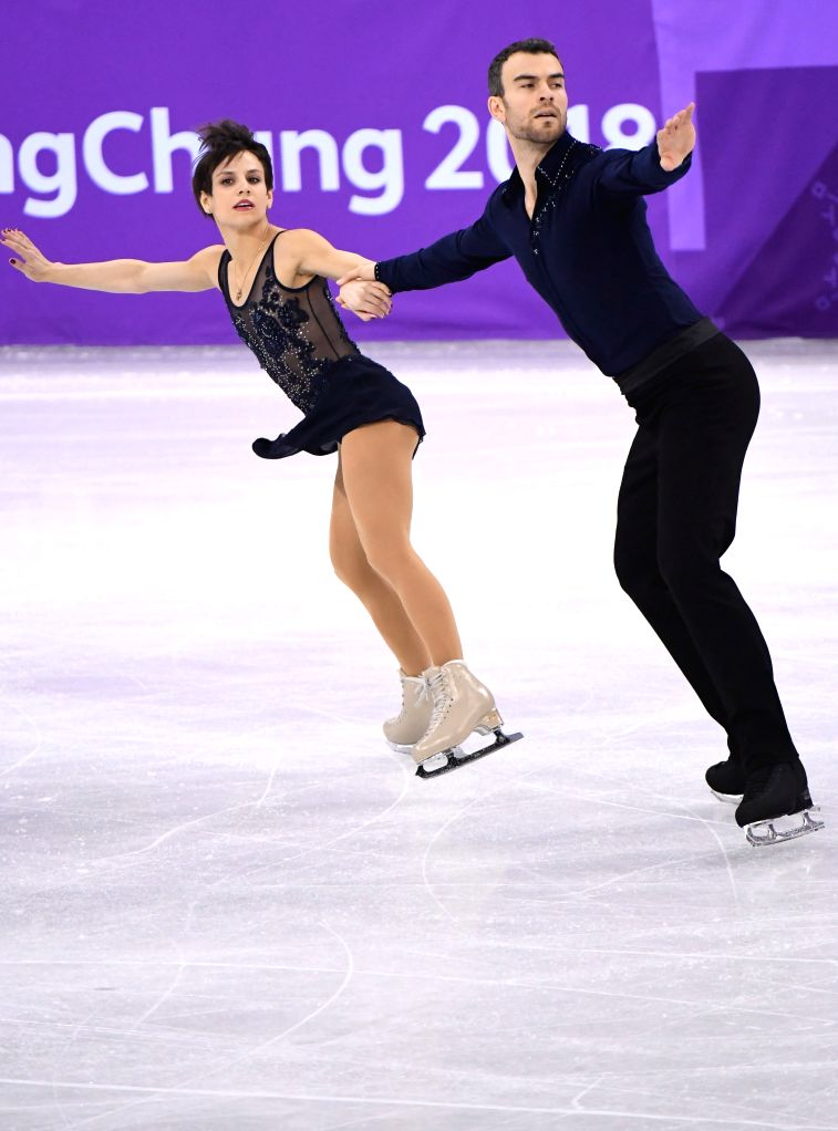 PYEONGCHANG, Feb. 14, 2018 - Meagan Duhamel (L) and Eric Radford of Canada compete during the pair skating short program of figure skating at the 2018 PyeongChang Winter Olympic Games, in Gangneung ...