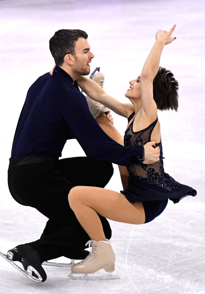 PYEONGCHANG, Feb. 14, 2018 - Meagan Duhamel (R) and Eric Radford of Canada compete during the pair skating short program of figure skating at the 2018 PyeongChang Winter Olympic Games, in Gangneung ...