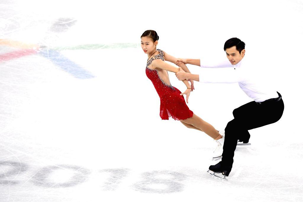 PYEONGCHANG, Feb. 14, 2018 - Peng Cheng (L) and Jin Yang of China compete during the pair skating short program of figure skating at the 2018 PyeongChang Winter Olympic Games, in Gangneung Ice Arena, ...