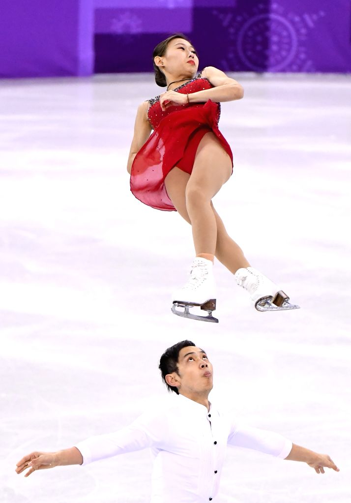 PYEONGCHANG, Feb. 14, 2018 - Peng Cheng (Top) and Jin Yang of China compete during the pair skating short program of figure skating at the 2018 PyeongChang Winter Olympic Games, in Gangneung Ice ...