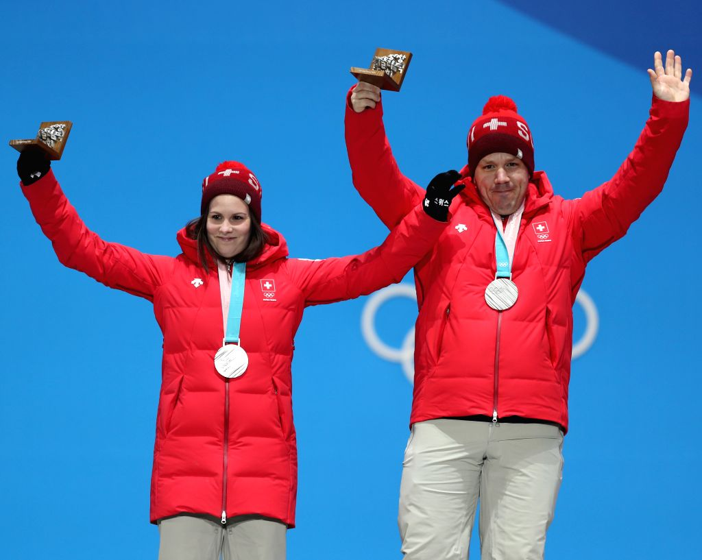 PYEONGCHANG, Feb. 14, 2018 - Silver medalists Jenny Perret (L) and Martin Rios of Switzerland celebrate during medal ceremony of the mixed doubles event of curling at 2018 PyeongChang Winter Olympic ...