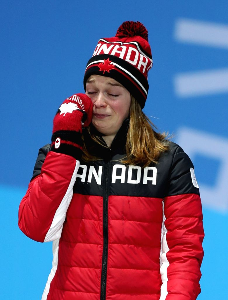 PYEONGCHANG, Feb. 14, 2018 - Third-placed Canada's Kim Boutin poses for photos during medal ceremony of the ladies' 500m event of short track speed skating at 2018 PyeongChang Winter Olympic Games at ...