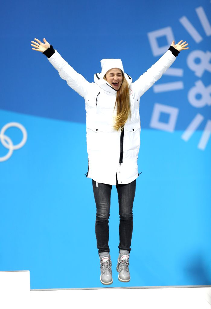 PYEONGCHANG, Feb. 14, 2018 - Third-placed Olympic athlete from Russia Yulia Belorukova celebrates during medal ceremony of ladie's sprint classic event of cross-country skiing at 2018 PyeongChang ...