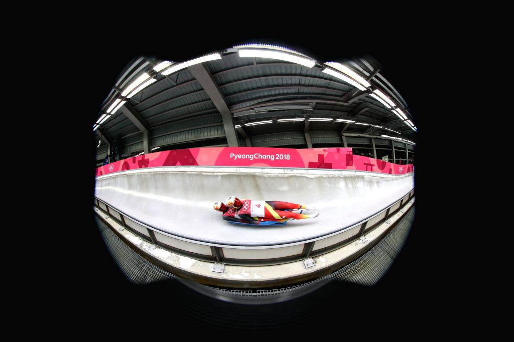 PYEONGCHANG, Feb. 14, 2018 - Third-Placed Toni Eggert and Sascha Benecken from Germany compete during men's doubles event of luge at 2018 PyeongChang Winter Olympic Games at Olympic Sliding Centre, ...