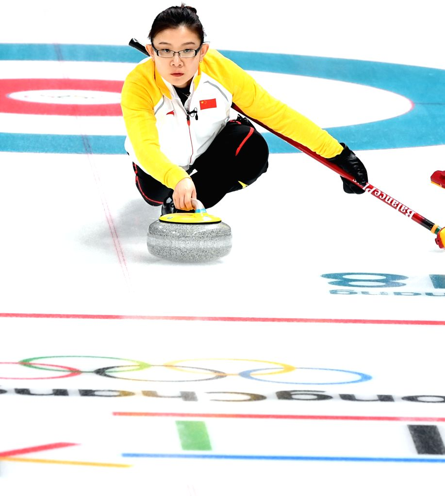 PYEONGCHANG, Feb. 14, 2018 - Wang Bingyu of China competes during women round robin event of curling against Switzerland at 2018 PyeongChang Winter Olympic Games at Gangneung Curling Centre, ...