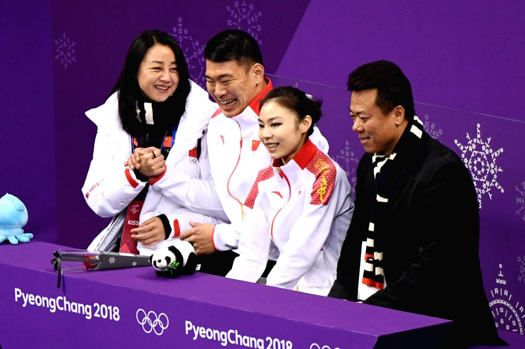 PYEONGCHANG, Feb. 14, 2018 - Yu Xiaoyu (2nd R) and Zhang Hao (3rd R) of China wait for scores after finishing the pair skating short program of figure skating at the 2018 PyeongChang Winter Olympic ...