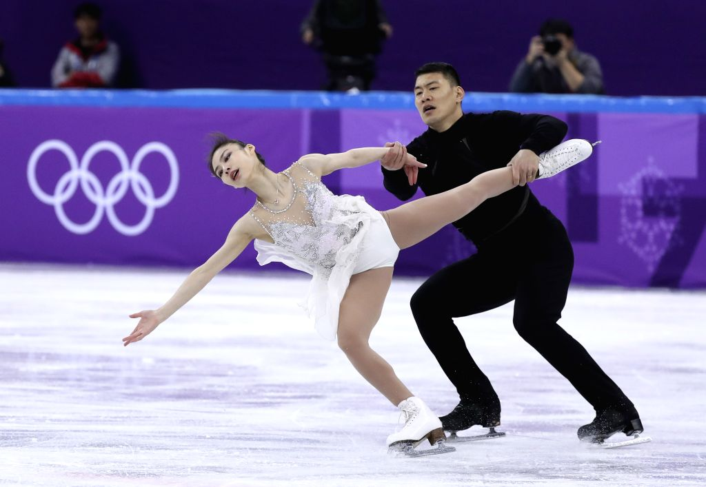 PYEONGCHANG, Feb. 14, 2018 - Yu Xiaoyu (L) and Zhang Hao of China compete during the pair skating short program of figure skating at the 2018 PyeongChang Winter Olympic Games, in Gangneung Ice Arena, ...
