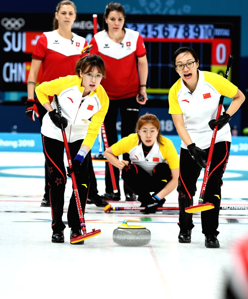 PYEONGCHANG, Feb. 14, 2018 - Zhou Yan (front R) and Ma Jingyi (front L) of China compete during women round robin event of curling against Switzerland at 2018 PyeongChang Winter Olympic Games at ...