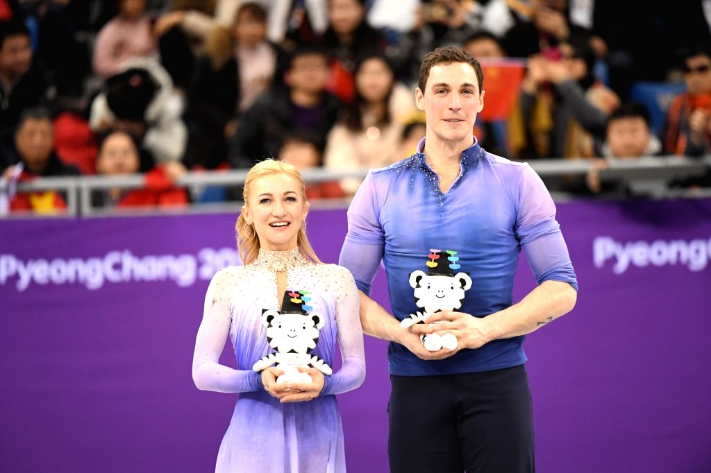 PYEONGCHANG, Feb. 15, 2018 - Aljona Savchenko (L) and Bruno Massot of Germany pose for group photos at the venue ceremony after the pair skating free skating of figure skating at the 2018 PyeongChang ...