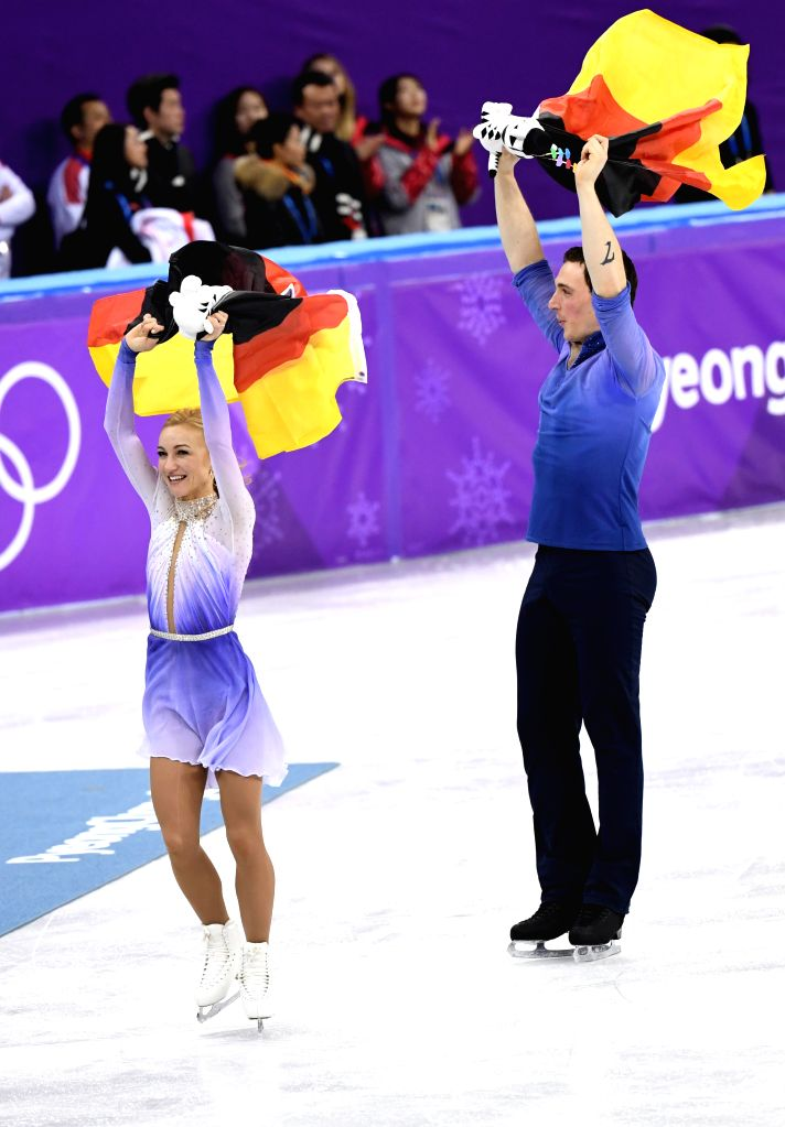 PYEONGCHANG, Feb. 15, 2018 - Aljona Savchenko (L) and Bruno Massot of Germany celebrate after winning the pair skating event at the 2018 PyeongChang Winter Olympic Games, in Gangneung Ice Arena, ...
