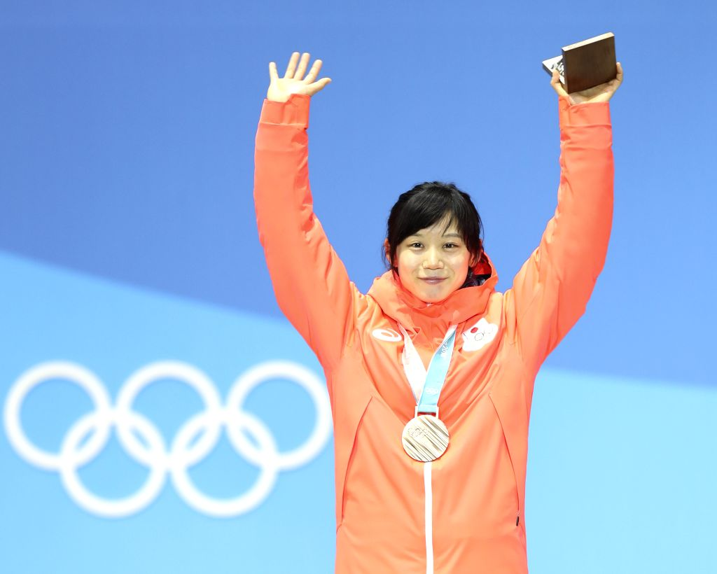 PYEONGCHANG, Feb. 15, 2018 - Bronze medalists Takagi Miho of Japan poses for photos during medal ceremony of women's 1,000m speed skating event at PyeongChang 2018 Winter Olympic Games at Medal ...