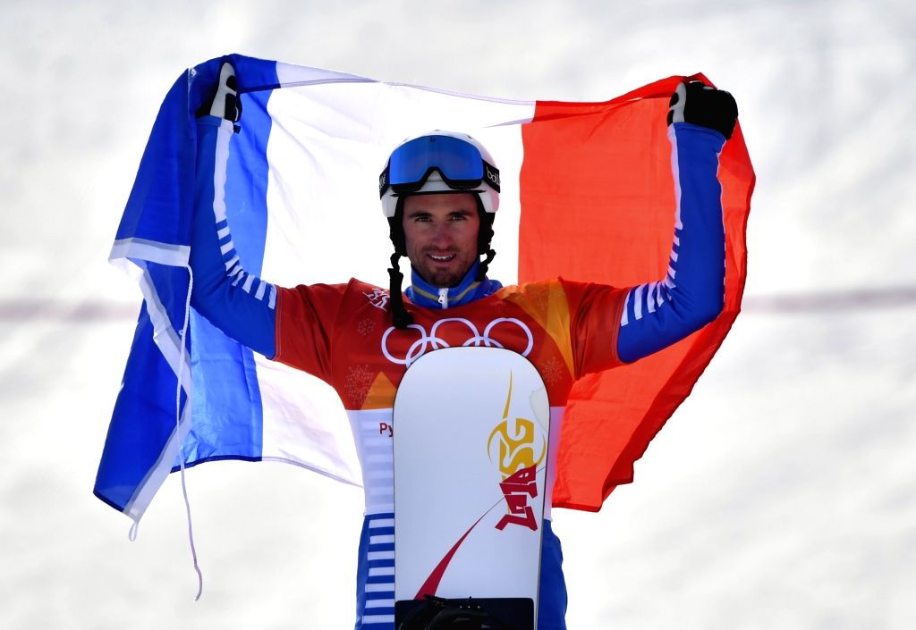 PYEONGCHANG, Feb. 15, 2018 - France's Pierre Vaultier celebrates during the venue ceremony of the men's snowboard cross final at the 2018 PyeongChang Winter Olympic Games, at Phoenix Snow Park, South ...