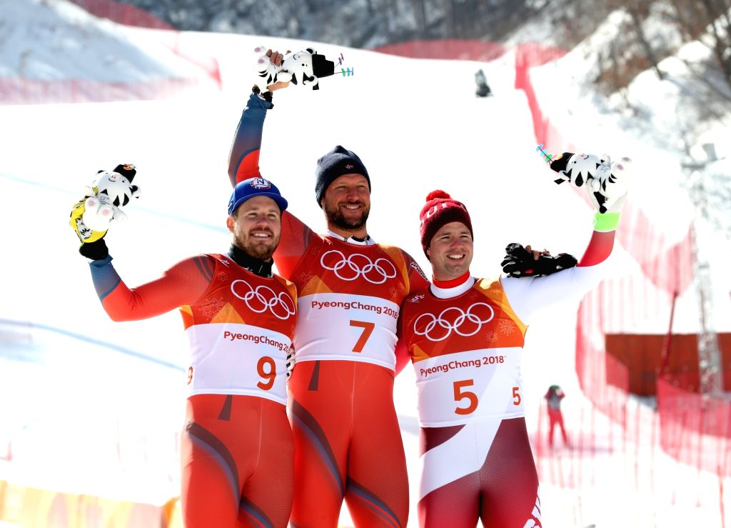 PYEONGCHANG, Feb. 15, 2018 - Gold medalist Aksel Lund Svindal of Norway (C), silver medalist Kjetil Jansrud of Norway (L), and bronze medalist Beat Feuz of Switzerland pose for group photos after the ...