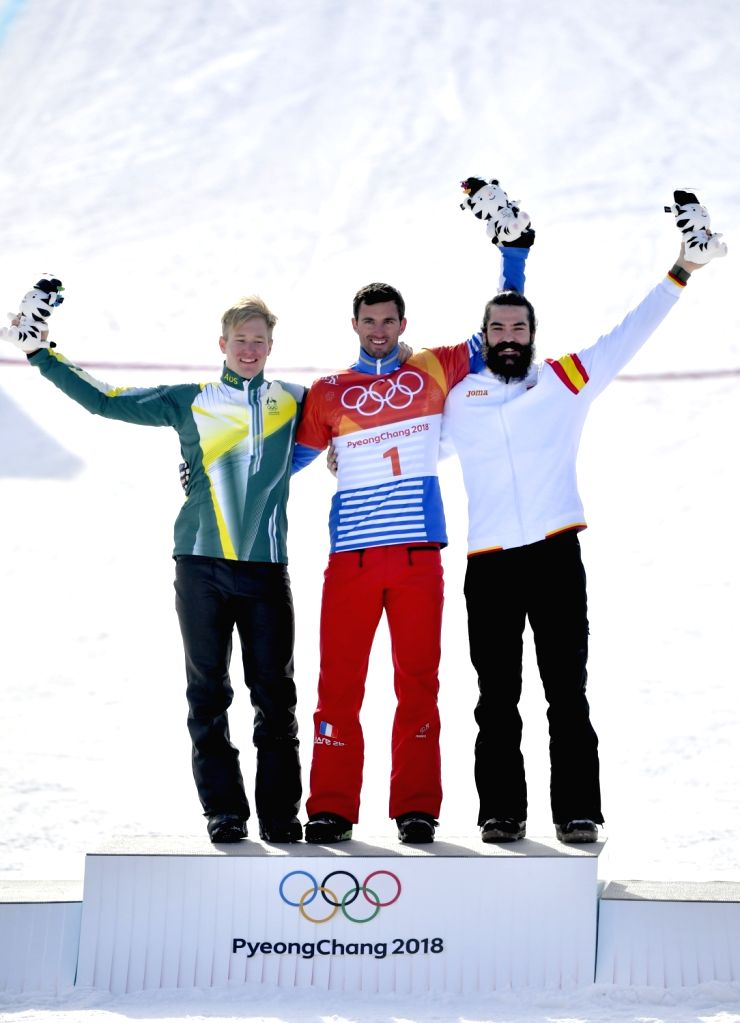 PYEONGCHANG, Feb. 15, 2018 - Gold medalist France's Pierre Vaultier (C), silver medalist Australia's Jarryd Hughes (L) and bronze medalist Spain's Regino Hernandez celebrate during the venue ceremony ...