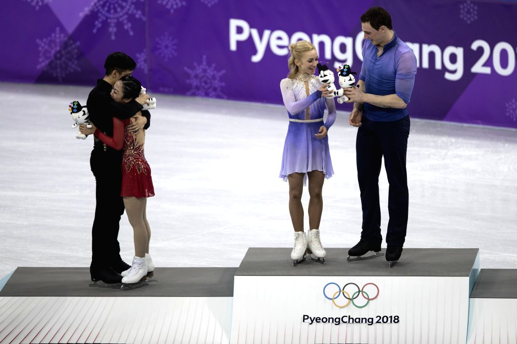 PYEONGCHANG, Feb. 15, 2018 - Gold-medalists Aljona Savchenko (2nd R) and Bruno Massot (1st R) of Germany, silver-medalists Sui Wenjing (2nd L) and Han Cong of China react during the venue ceremony of ...