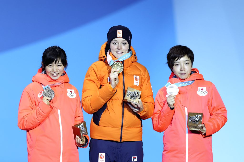 PYEONGCHANG, Feb. 15, 2018 - Gold medalists Jorien Ter Mors (C) of the Netherlands, silver medalists Kodaira Nao (R) of Japan and bronze medalists Takagi Miho of Japan pose for photos during medal ...
