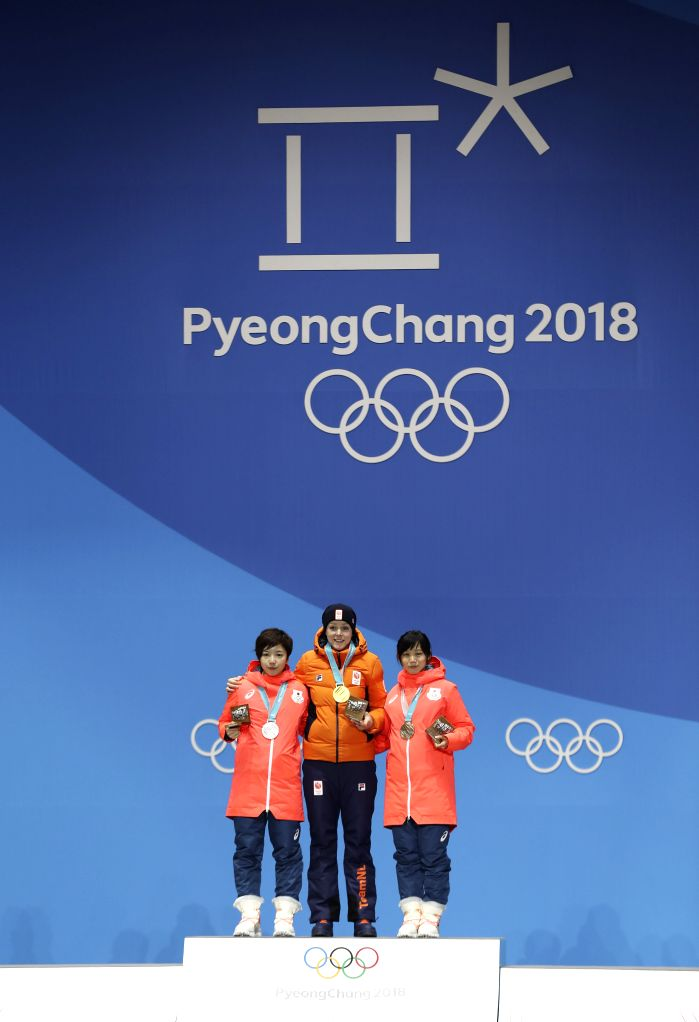 PYEONGCHANG, Feb. 15, 2018 - Gold medalists Jorien Ter Mors (C) of the Netherlands, silver medalists Kodaira Nao (L) of Japan and bronze medalists Takagi Miho of Japan pose for photos during medal ...