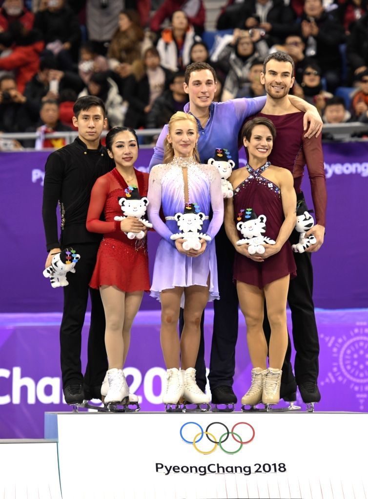 PYEONGCHANG, Feb. 15, 2018 - Silver medalist Sui Wenjing (2nd L) and Han Cong (1st L) of China, gold medalist Aljona Savchenko (3rd L) and Bruno Massot (4th L) of Germany, and bronze medalist Meagan ...